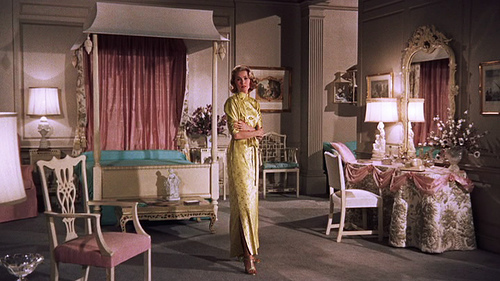 Grace kelly in a beautiful silky dressing gown